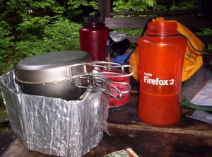 My cooking setup for dinner one night, with a Firefox 2-labeled water bottle full of hot chocolate