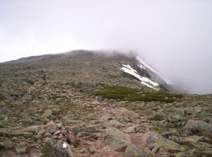 A fog-shrouded view of part of the trail up Katahdin, Eric and Toby in the distance