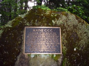 A plaque on a large rock along the trail recognizing the final constructed section of trail to make it a complete pathway