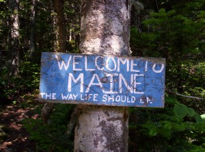 "The sign welcoming thru-hikers to Maine, which reads ""WELCOME TO MAINE: THE WAY LIFE SHOULD BE"""