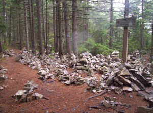 Rock cairns galore near the trail to White Rocks Cliff