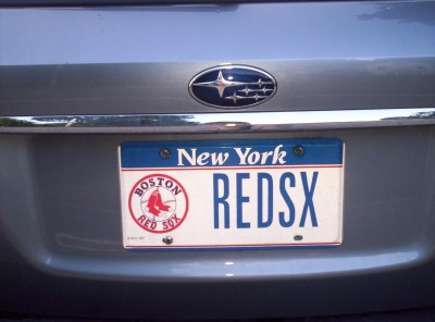 A Red Sox-branded New York vanity license plate with the letters REDSX on it; riddle me that, Batman