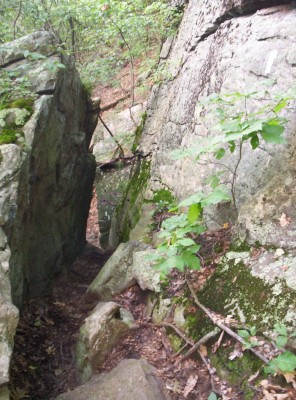 A narrow walk between boulders