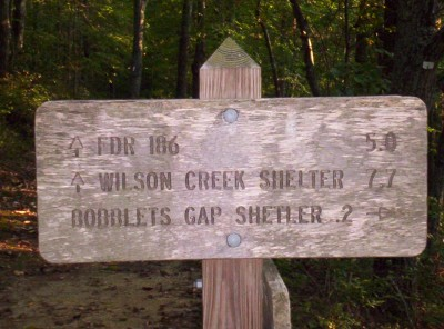 "Bobblets Gap Shelter side trail sign, northern side (with ""shelter"" misspelled as ""shetler"")"