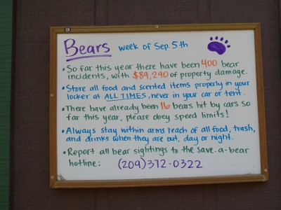 "Notice board with bear information; one bullet reads, ""So far this year there have been 400 bear incidents, with $89,290 of property damage."""