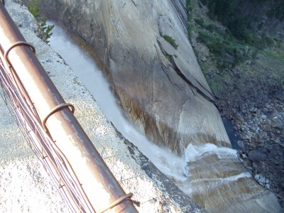 Nevada Falls, from the precipice, looking down over a guard rail at the water crashing down