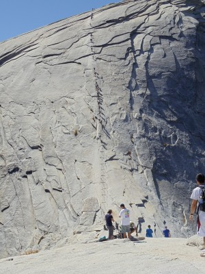 The final 400 feet of ascent up Half Dome (covering a somewhat greater horizontal distance, at angles approaching 45 degrees) require use of installed cables and wooden bracing, up which hikers must pull themselves to reach the top; the descent requires the opposite effort