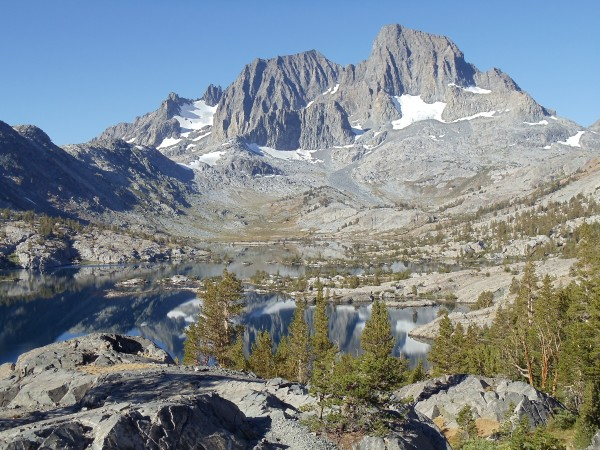 Mount Ritter and Banner Peak, seen over the rocky shore of Garnet Lake