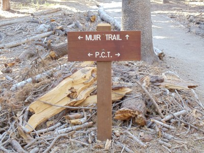 Trail sign: Muir Trail to left and straight ahead, Pacific Crest to left and to right