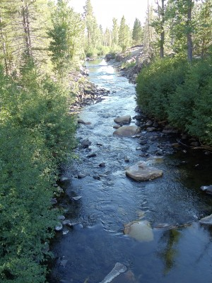 The San Joaquin Fork heads south to Rainbow Falls seen in late afternoon from a footbridge on the JMT