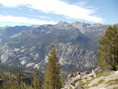 Mountains in the distance after an evergreen-covered valley just below