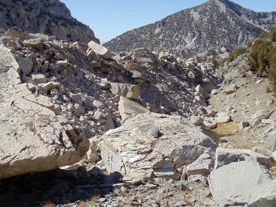 A small boulder-strewn depression just adjacent to the trail; the granite blocks remind me of toy blocks