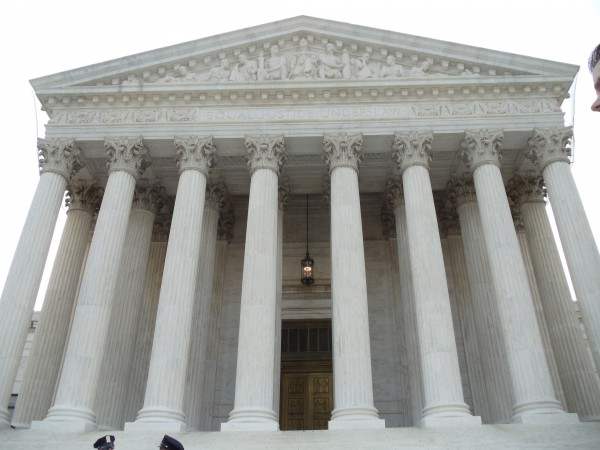 "The western pillars, doors, and frieze of the Supreme Court, intoning ""Equal justice under law"""
