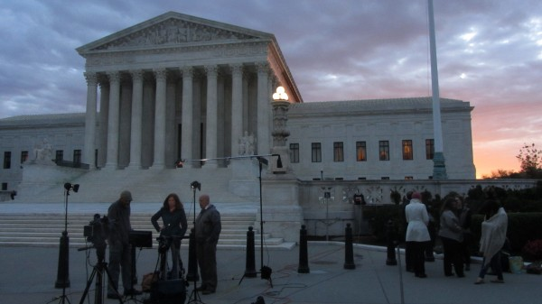 Sunrise over the Court, with a camera crew and reporter in the foreground
