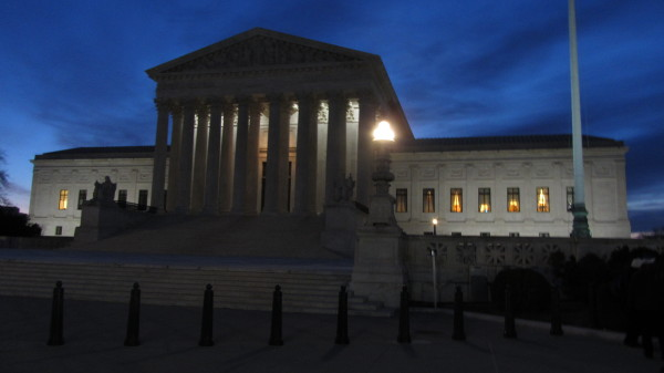 Early morning at the Supreme Court, on a cloudy morning with a mostly-blue sky at sunrise